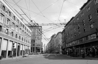 City street with transit wires. Bologna, Italy.