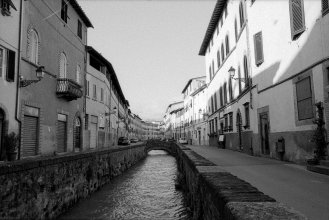 Residential street with canal. Lucca, Italy.